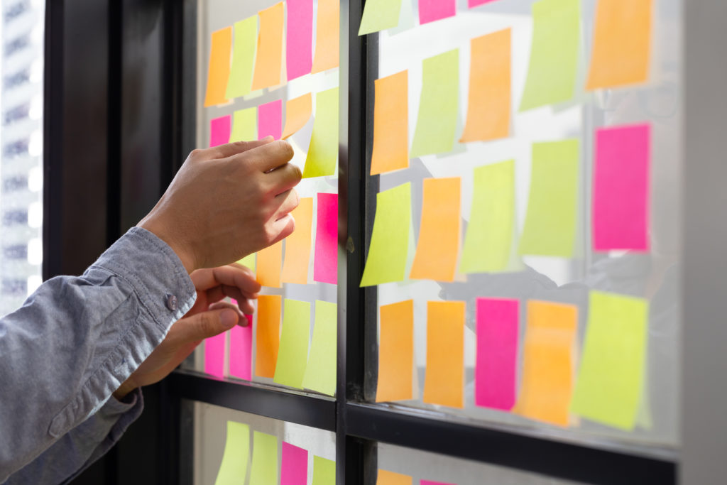 Sticky notes on a project management board scrum